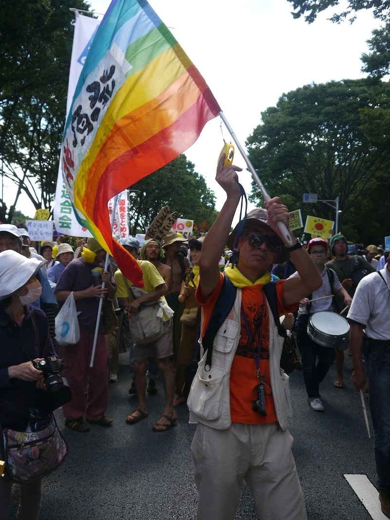 Man waving a rainbow flag